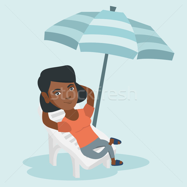 Young african woman relaxing on the beach chair. Stock photo © RAStudio