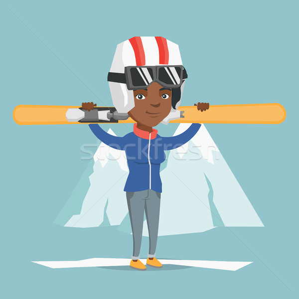 Young african-american sportswoman holding skis. Stock photo © RAStudio