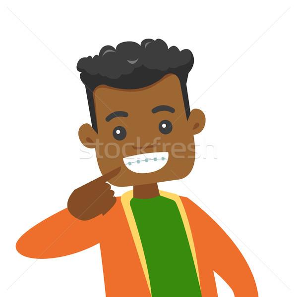 África hombre sonrisa dentales tirantes Foto stock © RAStudio