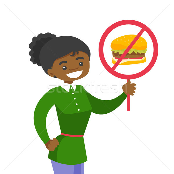 Young woman holding placard with no fastfood sign. Stock photo © RAStudio