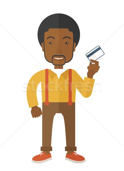 Boldog üzletember áll tart hitelkártya afrikai Stock fotó © RAStudio