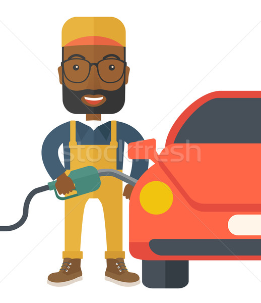 Gasoline boy filling up fuel. Stock photo © RAStudio