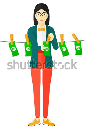 Business woman loundering money. Stock photo © RAStudio