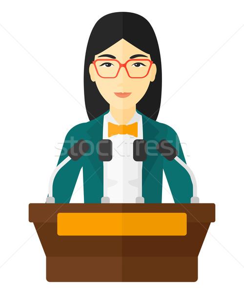 Woman speaking on podium. Stock photo © RAStudio