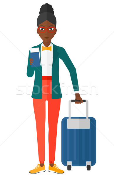Woman standing with suitcase and holding ticket. Stock photo © RAStudio