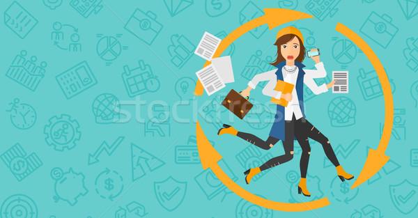 Woman coping with multitasking. Stock photo © RAStudio