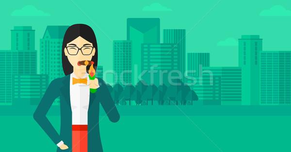 Stock photo: Woman smoking cigar.