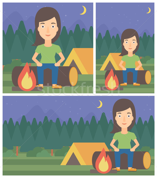 Woman sitting on log in the camping. Stock photo © RAStudio