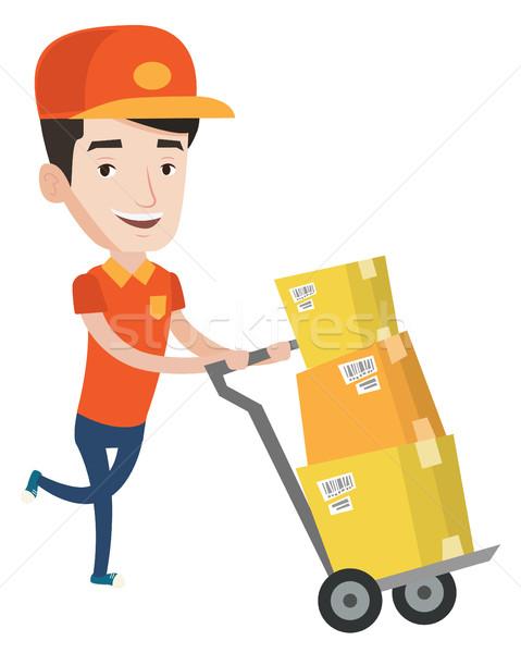 Levering postbode karton dozen jonge voortvarend Stockfoto © RAStudio