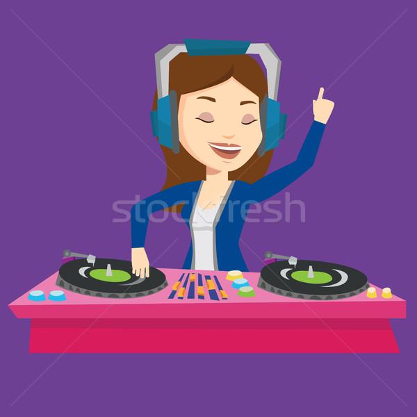 Müzik turntable genç kadın oynama güverte Stok fotoğraf © RAStudio