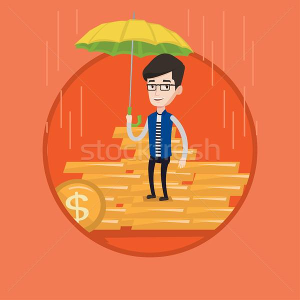 Businessman insurance agent with umbrella. Stock photo © RAStudio