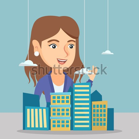Real estate agent presenting city model. Stock photo © RAStudio