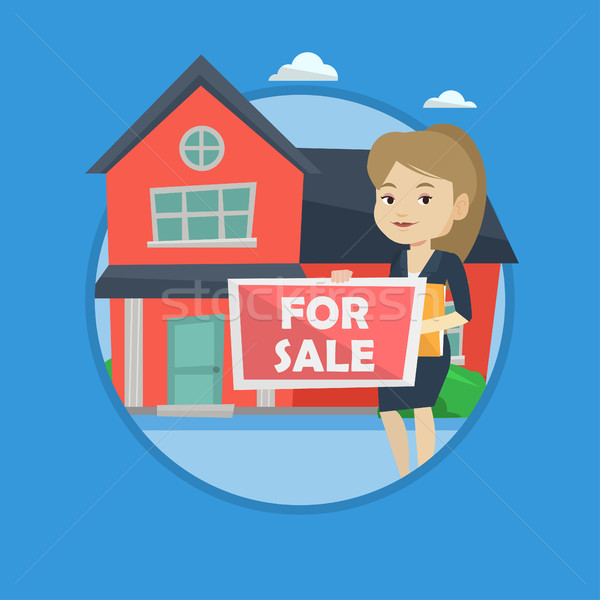 Young female realtor offering house. Stock photo © RAStudio