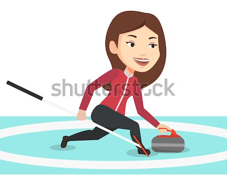 Stock photo: Curling player playing curling on curling rink.