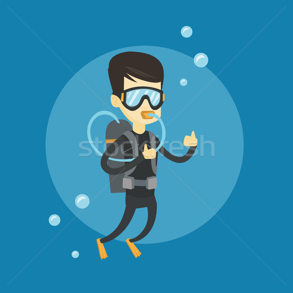 Man diving with scuba and showing ok sign. Stock photo © RAStudio