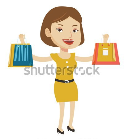 Happy woman holding shopping bags and gift boxes. Stock photo © RAStudio