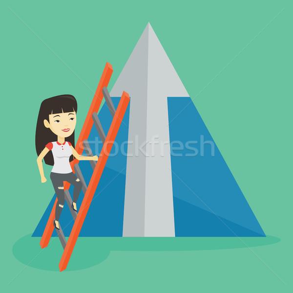 Business woman climbing on mountain. Stock photo © RAStudio