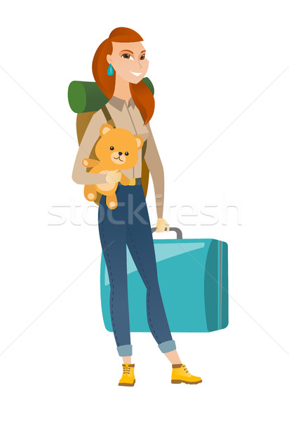 Woman traveling with old suitcase and teddy bear. Stock photo © RAStudio
