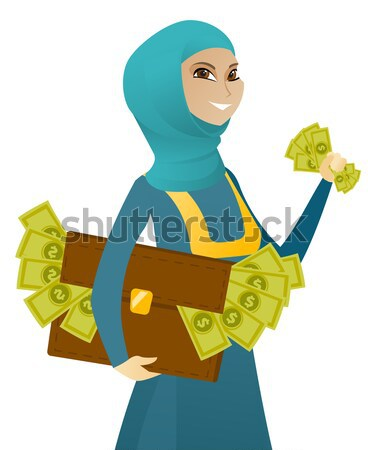 Asian business woman with briefcase full of money. Stock photo © RAStudio