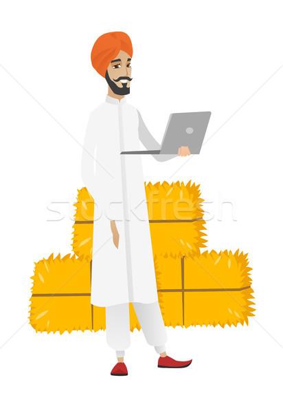 Hindu farmer using laptop. Stock photo © RAStudio
