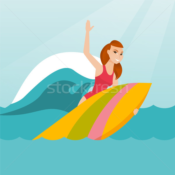 Stock photo: Young caucasian surfer in action on a surfboard.