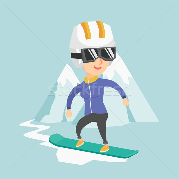 Stock photo: Young caucasian woman snowboarding.