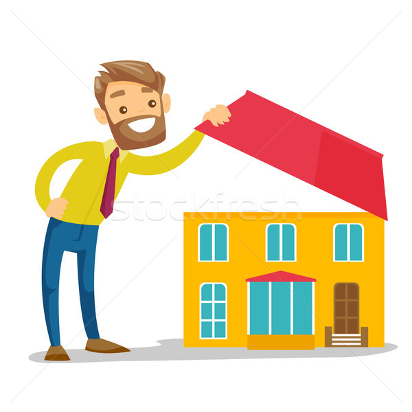 Young caucasian white man looking for a new house. Stock photo © RAStudio