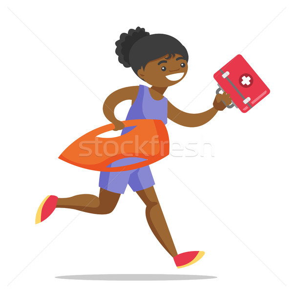 African lifeguard running with first aid box. Stock photo © RAStudio
