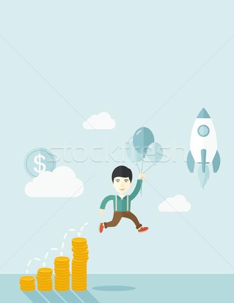 Asian businessman holding balloons. Stock photo © RAStudio