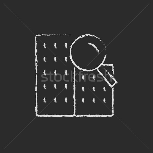 Condominium and magnifying glass icon drawn in chalk. Stock photo © RAStudio