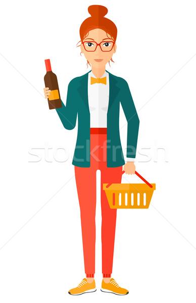 Vásárló bevásárlókosár üveg bor nő tart Stock fotó © RAStudio