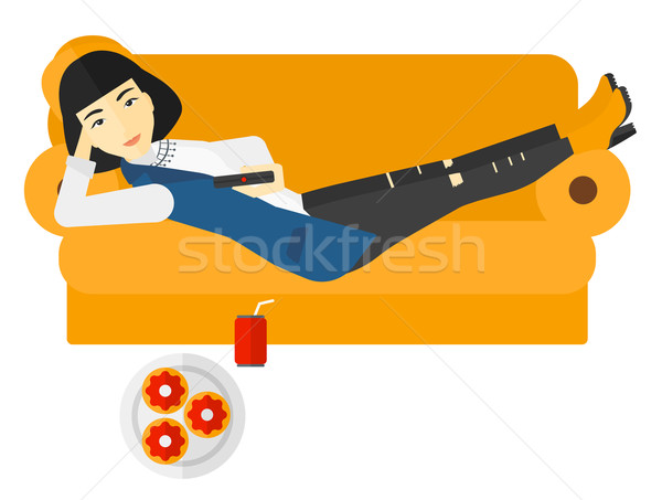 Stock photo: Woman lying on sofa with junk food.