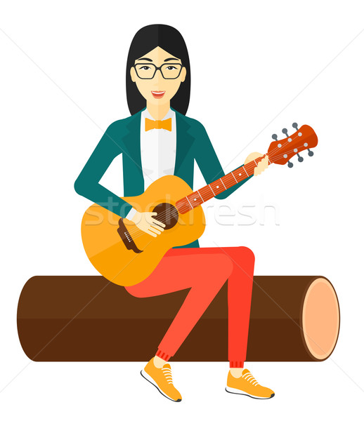 Woman playing guitar. Stock photo © RAStudio