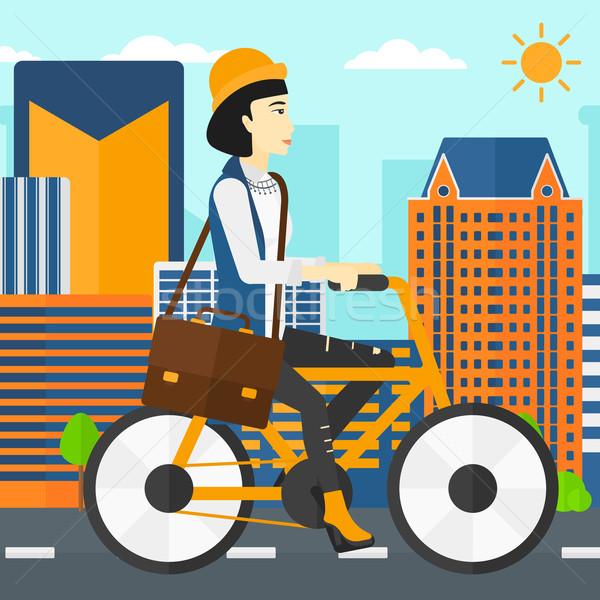 женщину Велоспорт работу азиатских портфель город Сток-фото © RAStudio