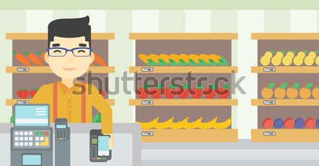 Customer paying with his smartphone using terminal. Stock photo © RAStudio