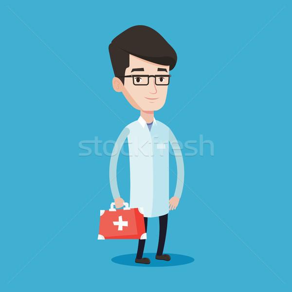 Doctor holding first aid box vector illustration. Stock photo © RAStudio