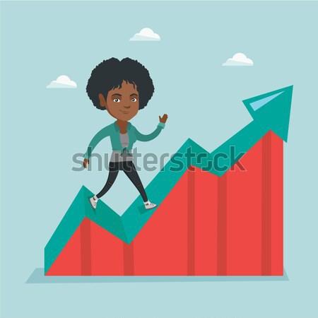 Happy business woman standing on profit chart. Stock photo © RAStudio