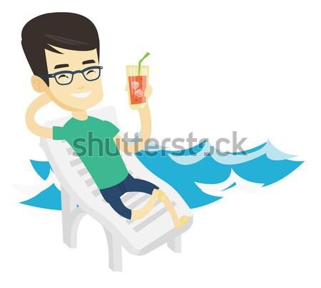 Człowiek relaks leżak asian wesoły pitnej Zdjęcia stock © RAStudio