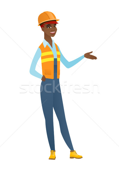 Builder with arm out in a welcoming gesture. Stock photo © RAStudio