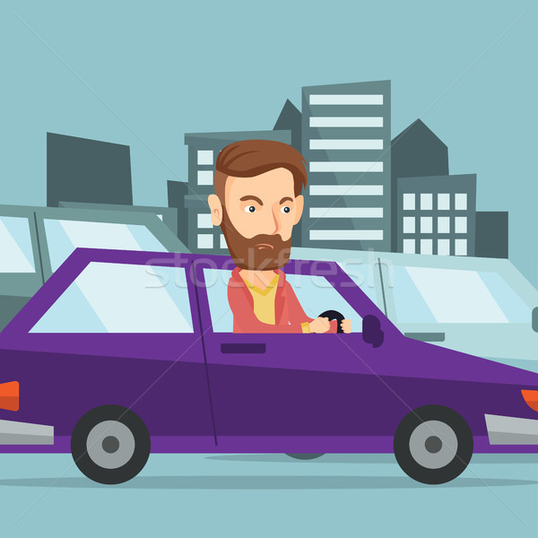 Stock photo: Angry caucasian man in car stuck in traffic jam.