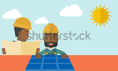 Young african-american builder laughing out loud. Stock photo © RAStudio