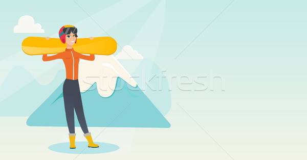 Young caucasian sportswoman holding skis. Stock photo © RAStudio
