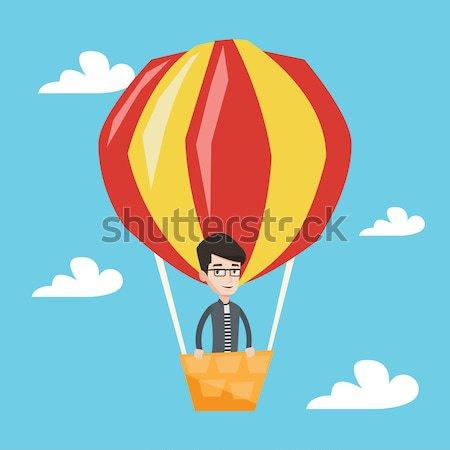 Man flying in hot air balloon vector illustration. Stock photo © RAStudio