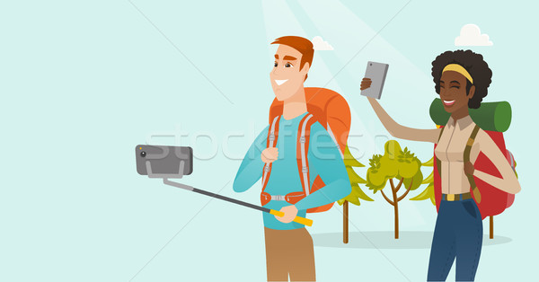 Young multiracial travelers making selfie. Stock photo © RAStudio