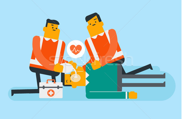 Doctors doing cardiopulmonary resuscitation. Stock photo © RAStudio