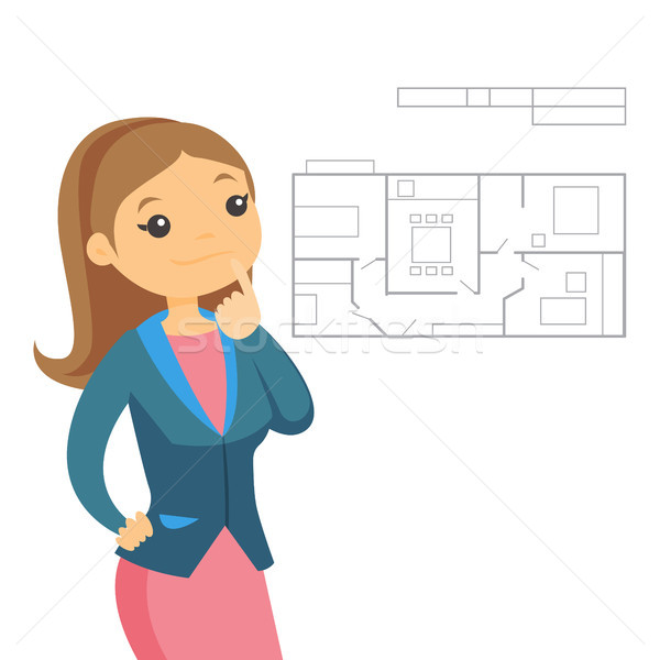 Woman thinking about blueprint of new apartment. Stock photo © RAStudio