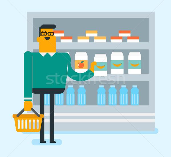 Caucasian man doing shopping in the supermarket. Stock photo © RAStudio