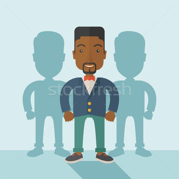 Black businessman standing straight with his shadows. Stock photo © RAStudio