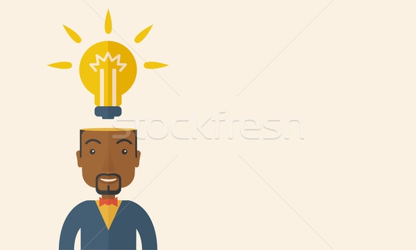 Black businessman with bulb on his head. Stock photo © RAStudio