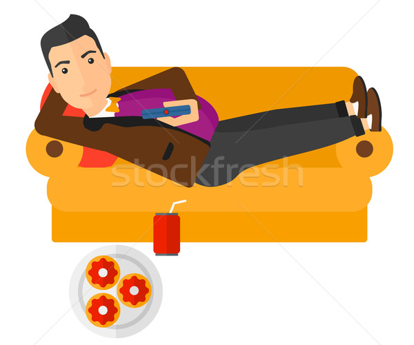 Man lying on sofa with junk food. Stock photo © RAStudio